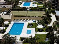 Aerial View of Pool and Tennis Court - Paradise Centre Apartments